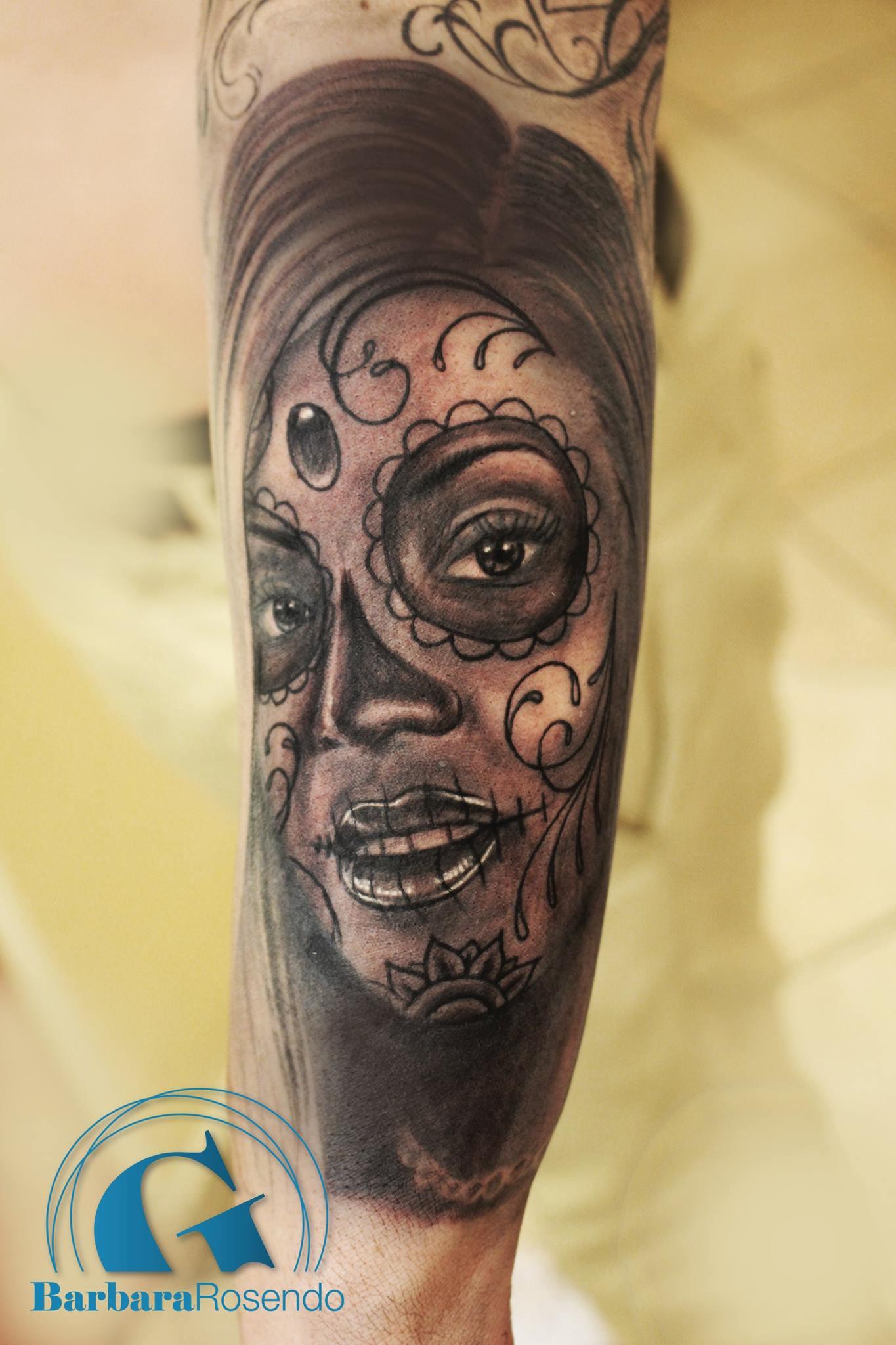 2 tetes de mort tatouage